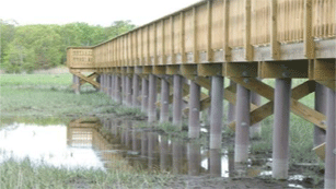 Image of wood pier supported by SUSTAINABLE FIBERGLASS COMPOSITE PILINGS