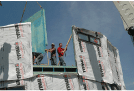 Image of a construction site crew putting together the outside panels