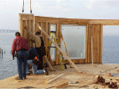 Image of a construction site crew installing an outside wall