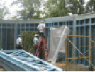 Image of a construction site crew building a blue structure from within