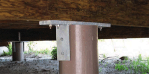 Image under a home with SUSTAINABLE fiberglass composite piling