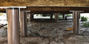 Image under a home with several SUSTAINABLE fiberglass composite piling