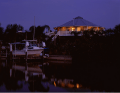 Image of a beautiful home exterior right on the canal in the evening