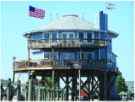 Image of a beautiful two story home exterior on the end of a long pier