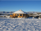 Image of a beautiful one story small home exterior in the snow