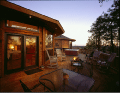 Image of a beautiful two story home exterior deck