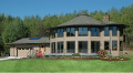 Image of a beautiful two story home exterior with gargage and left wing