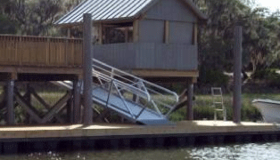 Image of a side view of a peir supported by sustainable FIBERGLASS COMPOSITE PILINGS