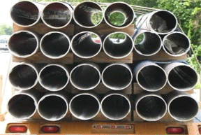 Image of sustainable FIBERGLASS COMPOSITE PILINGS stack of a truck