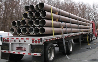 Image of sustainable FIBERGLASS COMPOSITE PILINGS stack of a truck, back view