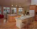 Image of an interior of kitchen and living area over looking out at the lake