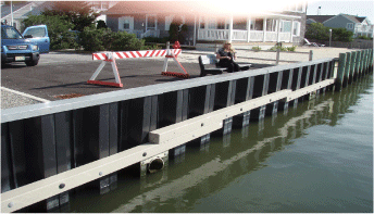 Image of coast guard next to a pier with SUSTAINABLE FIBERGLASS COMPOSITE PILINGS