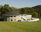 Image of a home built with insulation made from recycled paper, and uses a ground-source (geothermal) heat pump