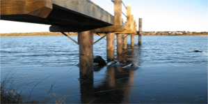 Image of under the pier supported by SUSTAINABLE FIBERGLASS COMPOSITE PILINGS way out in the water